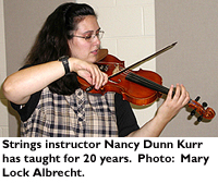 Strings instructor Nancy Dunn Kerr has taught for 20 years.