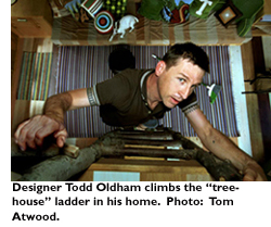 Designer Todd Oldham climbs the treehouse ladder in his home