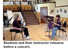 Students and their instructors rehearse before a concert.
