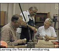 People learning woodcarving at School of Arts class/studio