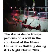 The Aeros dance troupe performs on a wall in the courtyard of the Mosse Humanities Building during Arts Night Out 2002.