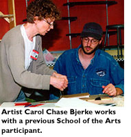 Artist Carol Chase Bjerke works with a previous School of the Arts participant.