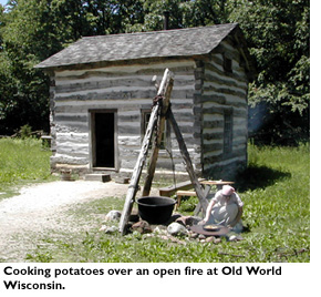 Cooking potatoes over an open fire at Old World Wisconsin.