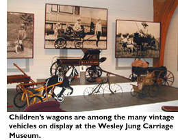Children's wagons are among the many vintage vehicles on display at the Wesley Jung Carriage Museum