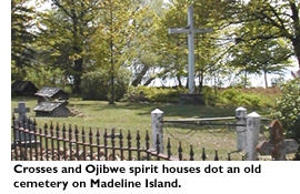 Crosses and Ojibwe spirit houses dot an old cemetery on Madeline Island.