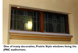 One of the many decorative, Prairie Style windows lining the JPAC auditorium.